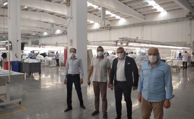 ''Fabrikalarda tedbirler alınarak üretim devam ediyor''