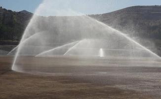 Yeşilyurt Belediyespor'un yeni stadında çim serim işlemi uygulandı